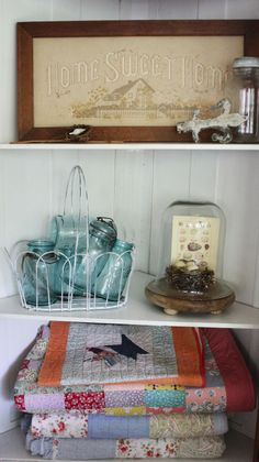 Beautiful vintage decor inside display cabinet by Itsy Bits & Pieces.  Shared at Knick of Time Tuesday - http://knickoftimeinteriors.blogspot.com/2014/06/knick-of-time-tuesday-139-vintage.html?showComment=1401852839823#c4352010410905710201