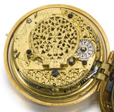 Henry Massy, London A FINE GOLD PAIR CASED QUARTER REPEATING VERGE WATCH CIRCA 1710 • Movement: gilded full plate, verge escapement, decoratively pierced and engraved balance cock with grotesque mask at the neck, three-arm brass balance, fusee and chain, round baluster pillars, repeating on a bell to the inside case back • Henry Massy (sometimes spelt Massey) was the son of the French protestant  Huguenot watchmaker Nicholas Massey. Henry was made a Brother in the Clockmakers' Company in…