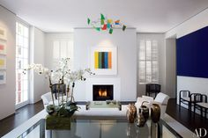 A Kelly work on paper and a George Rickey mobile add dashes of color to the serene white living room of Tina Alster and Paul Frazer's Washington, D.C., home designed by Jacobsen Architecture.