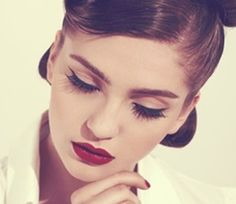 Bold red lips and simple eye line = Fierce and sultry.