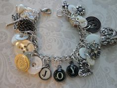 Joy charm bracelet made from recycled jewelry pieces, vintage buttons and typewriter key letters.