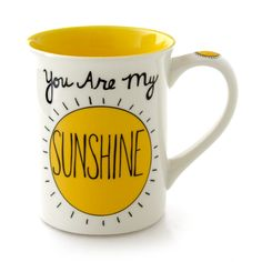 """Reads: """"You Are My Sunshine,"""" followed on the back by """"Love You to the Moon and back."""" This 16 oz stoneware mug is the perfect gift for a new parent. Designed by Lorrie Veasey. You are my sunshine mug"""