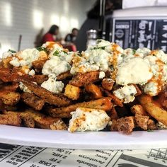 Buffalo loaded french fries with blue cheese