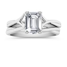 My Favorite and the one I actually got!!!, 6.9mm x 4.8mm Emerald cut White Sapphire  This modern design is a Shane Co. exclusive.  Crafted from superior quality 14 karat white gold, a smooth, polished finish gives this piece elegance and shine. This unique wedding set with a split shank serves to highlight the center diamond of your choice. Shown with a center stone Emerald Cut White Sapphire.
