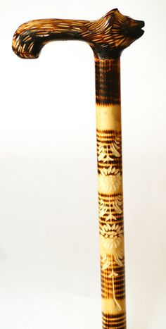 Golden brown handmade walking stick with hand carved handle into Wolf shape https://www.etsy.com/listing/215624663/hand-carved-unique-walking-stick-wooden