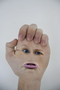 Face On Hand