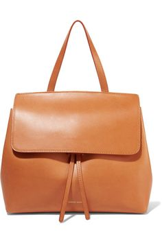 Scaled down to mini proportions, Mansur Gavriel's 'Lady' bag is sized to fit your diary and wallet, and the rose-colored interior is unlined for a lightweight feel. The 'Camello' vegetable-tanned leather is untreated and so will darken and wear naturally over time. Carry this style as a tote, attaching the shoulder strap to go hands-free on busier days.