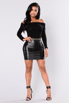 Black leather miniskirt and ankle strap heels