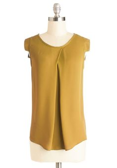 Jet Setter's Jewel Top in Amber. Let the delicately draped folds and amber hue of this silky, short-sleeved top accompany you on your next great journey! #yellowNaN