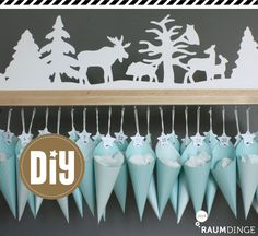 "raumdinge: Adventskalender ""Winterwald"" – mit Anleitung. I would do cones with Xmas vintage printouts!"
