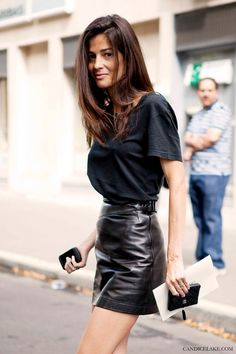 How to wear leather skirt? This outfit: leather mini black skirt and very simple t-shirt. Looks good!