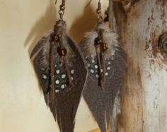 turquoise priestess leather feather earrings by WildHeartifacts