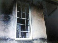 This photo from bethdolgner.com shows what appears to be a forlorn looking child staring out the window of Savannah's famously haunted home at 432 Abercorn Street. Legend has it a girl died in the house after her father tied her to a chair and left her to die of heat exhaustion. Could this be her or is it merely a case of  extreme madness ?