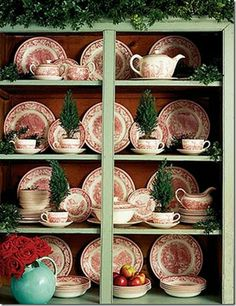 Currier & Ives, red holiday dishware..love the little trees in the cups:)