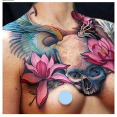 Jeff Gogue. skull, wings, lotus flowers. chest tattoo