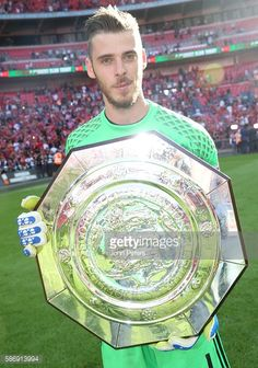 David de Gea of Manchester United poses with the Community Shield trophy after the FA Community Shield match between Leicester…
