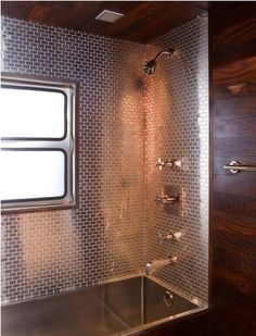 An Ann Sacks-steel-tiled spa area with a deep soaking tub.  What about the idea of steel or tin for an outdoor shower?