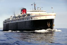 The SS Badger gets you from the shores of Ludington, MI to Manitowoc, WI in 4 hours, and it's a good float too.