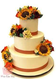 Rustic Themed Sunflower Wedding Cake by Pink Cake Box in Denville, NJ.  More photos and videos at http://blog.pinkcakebox.com/rustic-themed-wedding-cake-2010-09-27.htm (Wedding Cake Sunflower)