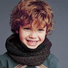 boy with wavy medium length curls
