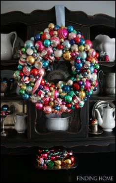 A gorgeous Vintage Ornament Wreath! So large & full. Now if you don't have a gazillion vintage ornaments on hand (or don't want to use them for this!), there's a tutorial for aging new ornaments included here. Vintage Christmas Ornaments, Christmas Love, All Things Christmas, Winter Christmas, Christmas Wreaths, Christmas Decorations, Christmas Ideas, Xmas, Holiday Crafts