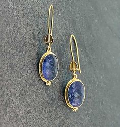 """Bask Tanzanite Earring - 18K yellow gold drop wire hook earring with oval tanzanites (7.6 total carat weight) bezel set with granulations. 1 1/4"""" long."""