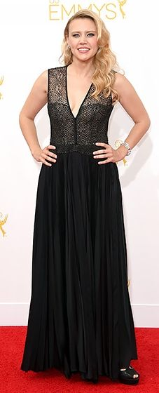 SNL funny lady Kate McKinnon wore a sexy black gown with a sheer bodice at the 2014 Emmys.
