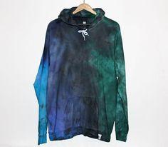 This American Apparel Tie Dye Hoodie is perfect for the colder months and for those summer nights on the beach! Available in any of the colours shown or