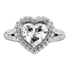 This glittering engagement ring is made of sterling silver and platinum plating. Ring features a sparkling heart shaped cubic zirconia stone. Stone weight measures approximately 3 3/4 carats.