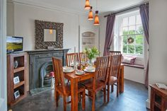 The cosy dining room with a slight gothic twist at Goshen Cottage in Kelso.