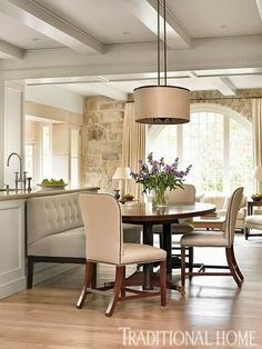 Chippendale chairs and a banquette create seating at this custom breakfast table. - Traditional Home ® / Photo: Emily Jenkins Followill / Design: Phoebe Howard