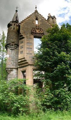 Abandoned Dunalastair Manor House, Perthshire, Scotland. The ruins now visible at Dunalastair are those of the third house to be built on the site, and are the remains ofd Baronial style mansion built in 1862 by General Macdonald, then owner of Dunalastair. The house was requisitioned during WW2, and subsequently used as a school for Polish refugees - said to have set fire to the dining room. Finally abandoned in 1952, it quickly became a derelict and roofless shell.