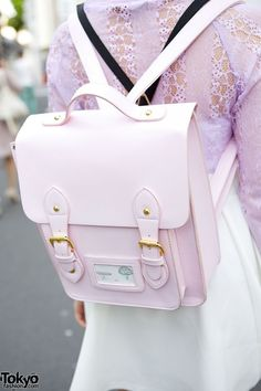 pastel pink satchel backpack. It's really cute and stylish and I really need a new bag...