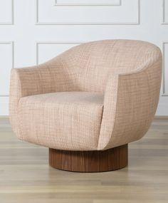 KELLY WEARSTLER | SONARA SWIVEL CHAIR. Upholstered seat atop a walnut cylindrical base with hidden swivel.