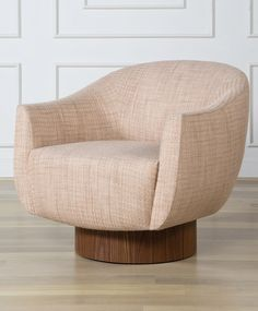 KELLY WEARSTLER | SONARA SWIVEL CHAIR. Upholstered seat atop a walnut cylindrical base with hidden swivel.