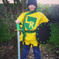 EASY DIY felt Knight costume! Took maybe an hour 1/2. 2 diff colors of felt, one 1yard, the other 1/2 yard. Use a regular sort to size a hole for the head. I free handed the chest decor. Hot glue gunned it to place. Added glitter glue. Cut a long strip for a belt & sword sash. I got a dollar tree sword & shield (which I spray painted for matching colors) I used a party hat & just cut & painted into the shape of a helmet. My son was beyond excited to wear this to Medieval day at school!!