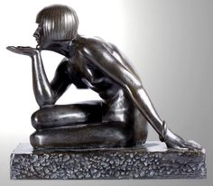 """An Art Deco patinated bronze by Maurice Guiraud-Riviere entitled """"L'Enigme """", France circa 1925."""