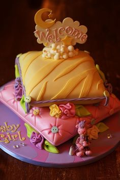 Stacked pillows baby shower cake by Andrea's SweetCakes, via Flickr.... The pleats and buttons are super cute
