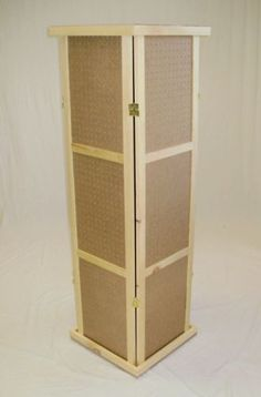 """Pegboard Spinner 58""""T TOP Base Hinged Folds Flat. Pegboard Tower, 58"""" tall. Each panel 14-3/4"""" wide x 58"""" tall, the 4 panels are hinged to fold flat. 1/4"""" hole pegboard, usable space 12"""" left to right. Top, 18"""" x 18"""". Revolving Base, 18"""" x 18""""."""