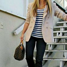 Black pants, striped shirt, khaki sweater