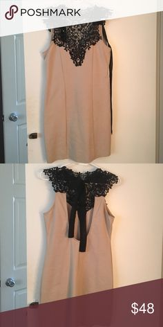 Tan bodycon dress with high neck lace detail Bodycon dress, black lace detailing, Ties in the back and has a U shape open back. Worn it once! Foreign Exchange Dresses