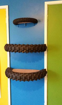 Shelves made from old motorbike tyres for our boys room