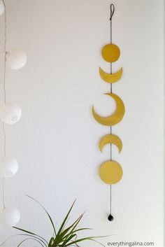 DIY Moon Phases Wall Hanging bohemian bedroom or dorm room decor easy to make. Inspired by Free People
