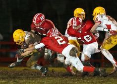 Hollister's Lionel Munguia (2) and Jorge Perez (60) work to bring down the Palma ball runner during their game Friday.