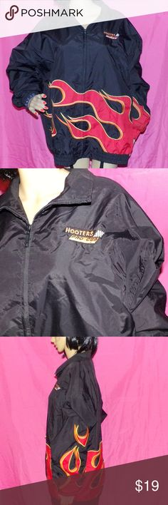 """Hooters Pro Cup Series Jackets Flames NASCAR Hooters Pro Cup Series Jackets Flames Racing NASCAR Embroidered Vintage Jacket size This is from the early 2000's and it is from a collection. It is made by Hilton Corporate Casuals and is in Very Good-Excellent a few small marks from use wonderful vintage find! This is a black with flames wrapping all the way around all nicely Embroidered along with the logo on the front and it is made of 100 % Nylon so it's all but waterproof Measurements L-29""""…"""