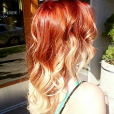 Bright coppery red melted into platinum Ombre. Hair by Danni Sjoden at Pheobe Therese Salon in Denver, Co.