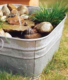 Mini Potted Ponds http://media-cache4.pinterest.com/upload/12877548904504753_vEZJcUar_f.jpg spoan backyard redo