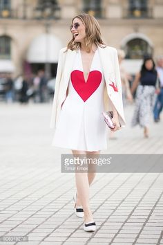 olivia-palermo-seen-wearing-a-white-dress-with-a-heart-on-it-in-the-picture-id808318278 (396×594)