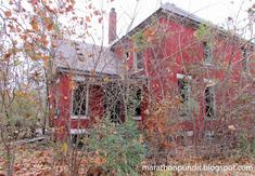 Abandoned red-brick home in autumn in Detroit's Delray neighborhood
