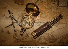 stock photo : Vintage map with compass and telescope